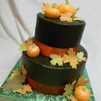 1318327642.jpg This is a cake for a fall family reunion. Icing is buttercream tinted to a dark brown. Gumpaste leaves and fondant pumpkins.