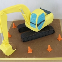 Yellow Digger   All cake, except the arm of the digger and the road cones [candle holders] which are just icing