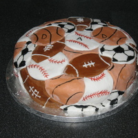 Sports Balls Cake Perfect for my Dad! Cherry chocolate cake with chocolate buttercream and sugarpaste ball shapes. I used the Wilton cookie cutters to get...