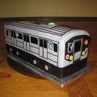 New York Subway Train I made this cake for a birthday party at the NY Transit Museum. Yellow cake w/chocolate bc filling. Covered with fondant. Detailed with...