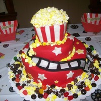 Movie Themed Cake I made this for my husbands 30th birthday. The popcorn is made out of mini marshmallows which I cut and painted yellow with food coloring...