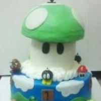 Mario Brothers Cake Thanks everyone on CC for the ideas to do this cake. White cake with bottom vanilla BC icing, top is pistachio flavor BC icing, fondant...