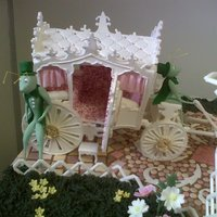 Koets   Entry for a show held in SA. All icing decorations with the odd flower wire support.