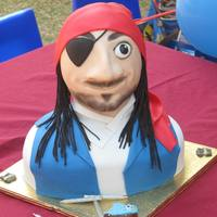 Seerower   Pirate with chocolate body and RKT head. Fondant decorations - all edible including hair.