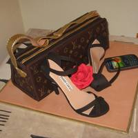 Lv Cake  Handbag - chocolate cake and all fondant decorations. Shoes made from gumpaste. Mobile done with edible print. All edible. A very happy...