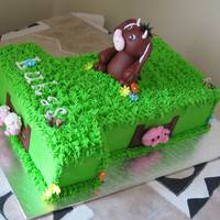 Plaasdiertjies   Buttercream decorated chocolate cake. Fondant animals and other decorations.