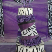 Purple Zebra Cake  8, 10 inch double carved, and 16 ich cake. The top 2 were purple vanilla cake, and the bottom tier was strawberry cake all covered with...