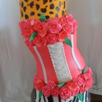Tipsy Quince Cake  This was a display cake I made just for fun. 6,double 10 inch carved, and a 12 inch. all mmf with mmf roses. I really like how it turned...
