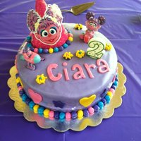 Abby Cadabby! I made this cake for a 2 year old's birthday party! It is covered in fondant and all of the decorations are made from fondant, too!...