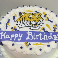Lsu Cake Made this for my brothers birthday. There was a picture on the website that inspired me, unfortunately I do not remember the name.