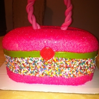 9 Yr. Old B-Day Cake Chocolate cake w/ strawberry filling and cover with bubblegum flavor fondant..,sprinkles,and sugar