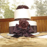 "Delynn & Mike 6 & 10"" with chocolate roses and dark brown ribbon"