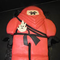 "His Ninjango Red ninjango, Kai carved from i/2 sheet and 2 8"" rounds, covered in marshmellow fondant."