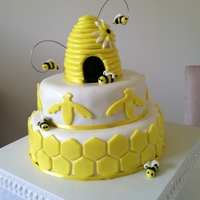 Bumble Bee Cake Layered Cake covered in Fondant. Butter caked with Honey Buttercream, Chocolate Cake with White Chocolate Buttercream
