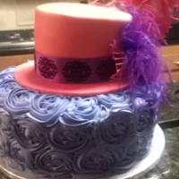 Red Hat Society Birthday  Top tier (hat) is french vanilla almond covered in cherry fondant. Bottom tier is swiss chocolate with bavarian cream buttercream roses....