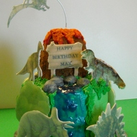 Dinosaurs, Volcanos 2 layer vanilla cake, with fondant accessories.