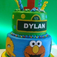 Sesame Street Chocolate and Vanilla cakes with buttercream icing. Fondant accessories.My first Sesame Street cake. Thanks CCer's for all the...