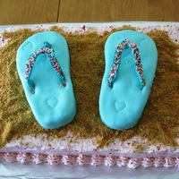 Flip Flop Cake This was for a pool party. The sand is crushed graham crackers. The cake was strawberry with fresh strawberry swiss meringue buttercream...