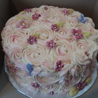 Buttercream Swirls   Simple cake. Buttercream swirls with a few fondant flowers and some lustre dust.