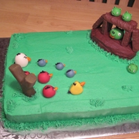 Angry Birds Cake Vanilla cake with BC icing, MMF decorations and Twix for the pigs hidout.