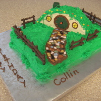 Hobbit Hole Cake Lemon Cake With Lemon Bc Icing And Fondant Trim Rock Path Is Chocolate Candy And Fence Is Pretzels Covered In Chocolate A... Hobbit Hole Cake. Lemon cake with lemon BC icing and fondant trim. Rock path is chocolate candy and fence is pretzels covered in chocolate...