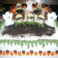 Halloween Brithday Cake WASC w/buttercream icing. Decorations are candy, milano cookie headstones, peep ghosts