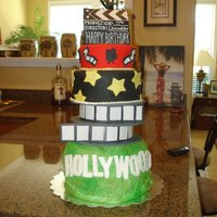 Hollywood Cake All decor is fondant .. bottom layer frosted in bc, everything else is covered In fondant. My first attempt at a tall cake that needed lots...