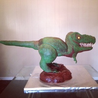 Trex Cake was approximately 22h x 41l x 15w, supported by a pvc structure. Head, legs, and tail are RKT, torso is cake. It is covered in...