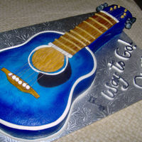Guitar Cake Cake I just finished for a music recital surprise, it is chocolate cake with buttercream filling covered with fondant and airbrushed blue....