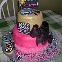 Hollywood Cake Marble cake with buttercream filling, covered with fondant and fondant accents