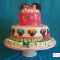Bellas Birthday Cake Cake made to match Minnie mouse bowtique theme. The client added 2 toys at the party