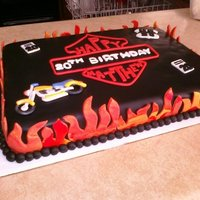 Motorcycle Themed Birthday Cake This cake was for a close friend's son that is special needs. They took him out for a motorcycle ride on his birthday and surprised...