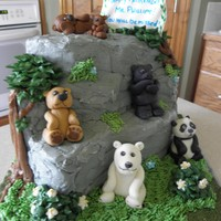 "Bears! Someone retiring who loved bears and was known as ""the bear"". Cake is iced in buttercream, bears made of mixture of MMF/gumpaste..."