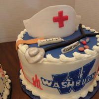 Rn Graduate Accessories made of gumpaste and fondant, iced and college logo in buttercream