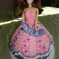 "Tayla's Doll Cake all in buttercream with a MMF banner and gumpaste ""4"". Disco Dust on the pink and purple dots and on the bodice."