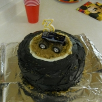 "Monster Truck Tire Cake One of the most simple cakes to make! Two round cakes with black buttercream. The ring ""dirt"" is brown sugar"