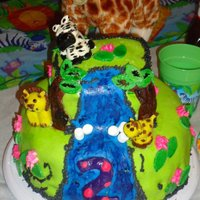 Jungle Animals So this is my 2nd fondant cake.... got the idea from someone else on here. I have a lot of problems with Fondant so I am still learning....