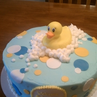 Rubber Duckie You're My Pal baby shower cake with buttercream frosting and modeling chocolate polka dots.