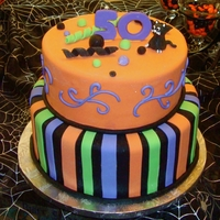 Halloween 50Th Birthday Client wanted black and orange cake with the family black cat, but not too much Halloween and masculine for this 50th Birthday. They were...