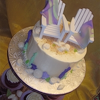 "Purple/green Coral Beach Cake 6"" Beach cake and cupcake tower. Purple and green coral with white chocolate shells."