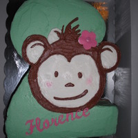 Florences 2Nd Birthday Vanilla cake with b/c, sugar sheet flower and name. Hand cut the name and flower, freehanded the monkey. Tfl