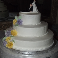 Lavender And Yellow Chiffon B/c with g/p roses and leaves. Vanilla cream cake. Tfl