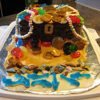 Treasure Chest Cake Inspired by the many similar cakes on Cake Central. For seven year old Noah. The top is RK but it was still heavy so did not end up on top...