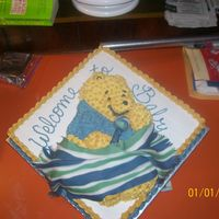 "Pooh Baby Shower I just used a 16"" square cake and the pooh shaped cake as the top layer and decorated. Blue shirt on pooh since it is going to be a..."