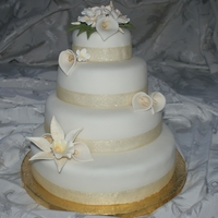 Ivory And Gold Wedding Cake With Gumpaste Flowers