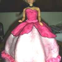 Barbie Carrot cake with cream cheese filling.Fondant dress in pink and black.