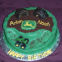 John Deere   Chocolate cake with Chocolate Ganache filling and buttercream icing. Was made for a Grandpa's and Grandsons birthday.