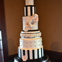 "Black And White Glam Cake This was one of those cakes that the bride gave me a budget, gave me a bunch of pics and then said ""surprise me!"" She was..."