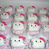 Hello Kitty Cupcakes   White cake with pink buttercream. Hello Kitty's are made from Rice Krispy Treats and covered with marshmallow fondant.