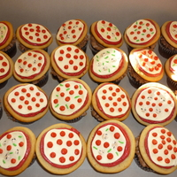Pizza Cupcakes Chocolate cupcakes with chocolate buttercream. Topped with a sugar cookie pizza. Sauce is red icing. Cheese, mushrooms and peppers are made...